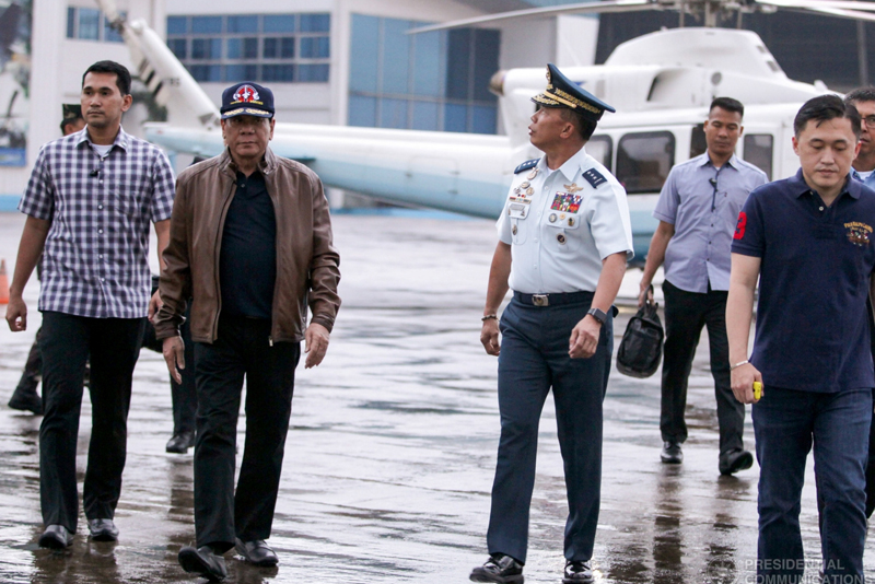 President Rodrigo Duterte is welcomed by Philippine Air Forces officials during his visit at Villamor Air Base in Pasay City on June 15, 2017. Palace/Released