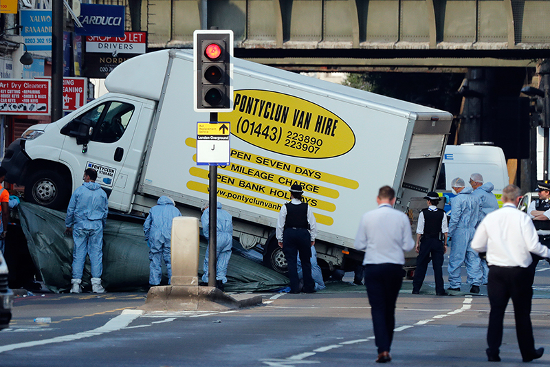 Forensic officers move the van at Finsbury Park in north London, where a vehicle struck pedestrians in north London Monday, June 19, 2017. The vehicle struck pedestrians near a mosque in north London early Monday morning. AP/Frank Augstein