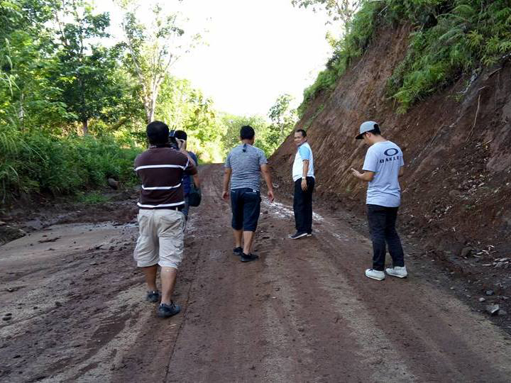 Engineers inspect a newly opened section of the 55-kilometer ARMM-funded Basilan Transcentral Road project. Philstar.com/John Unson