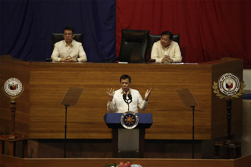 President Rodrigo Duterte delivers his second State of the Nation Address before a joint session of Congress on Monday, July 27, 2017. Behind him are Senate President Koko Pimentel and House Speaker Pantaleon Alvarez. Philstar.com / AJ Bolando