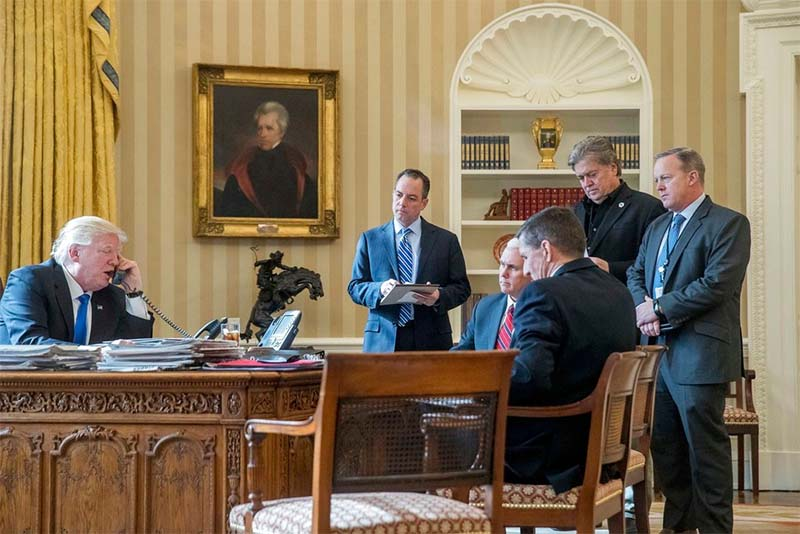 In this Jan. 28, 2017 file photo, President Donald Trump, accompanied by from second from left, Chief of Staff Reince Priebus, Vice President Mike Pence, National Security Adviser Michael Flynn, Senior Adviser Steve Bannon, and White House press secretary Sean Spicer, speaks on the phone with Russian President Vladimir Putin, in the Oval Office at the White House in Washington. AP/Andrew Harnik