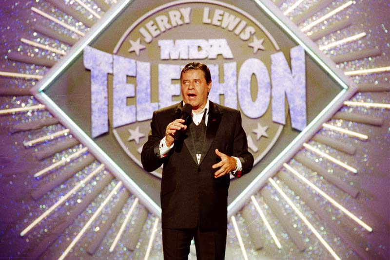 In this Sept. 2, 1990, file photo, entertainer Jerry Lewis makes his opening remarks at the 25th Anniversary of the Jerry Lewis MDA Labor Day Telethon fundraiser in Los Angeles. AP/Julie Markes, File