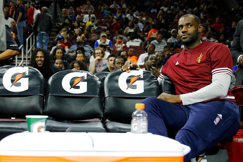 This Oct. 8, 2015, file photo shows Cleveland Cavaliers' LeBron James watching from the bench during a timeout during the second half of an NBA preseason basketball game in Philadelphia. AP/Matt Slocum, File