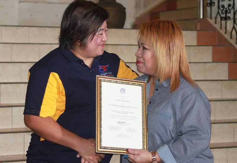 Cotabato City Mayor Cynthia Guiani-Sayadi (right) received on Monday from Grace Belgado-Sequeton, director of the Civil Service Commission-12, a plaque stating she is a candidate for the Presidential Lingkod Bayan Award.