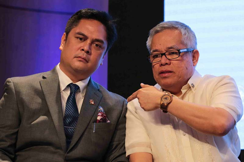 Presidential Communications Secretary Martin Andanar and Trade Secretary Ramon Lopez chat on the sidelines of the second edition of the DuterteNomics Forum at Conrad Manila in Pasay City on April 25, 2017. PPD/Albert Alcain