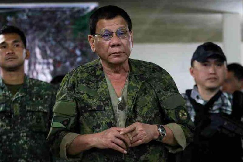 In this July 20, 2017 photo, President Rodrigo Duterte visits government troops who are engaged in a battle with the Maute terrorist group in Marawi City on July 20, 2017. The President gave out food packs and other assistance when he set foot at Camp Ranao. PPD/Ace Morandante