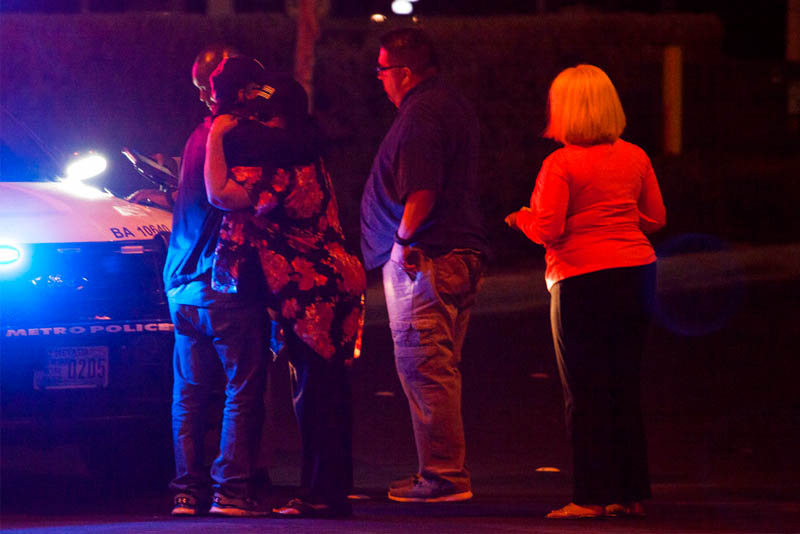 People embrace after arriving at Metro Headquarters to check on loved ones early Monday, Oct. 2, 2017, after a mass shooting at a music festival on the Las Vegas Strip Sunday. Yasmina Chavez/Las Vegas Sun via AP