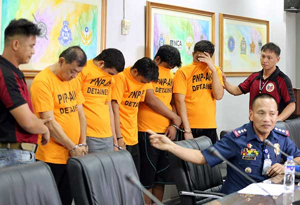 PNP-AKG head Senior Superintendent Glenn Dumlao presents the suspects in the kidnapping of a Chinese man and two Koreans at Camp Crame yesterday. The victims were rescued in Guiguinto, Bulacan on Monday night. BOY SANTOS
