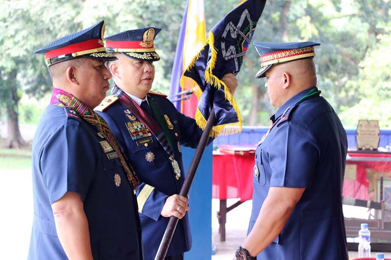 "Police Director General Ronald ""Bato"" Dela Rosa at the symbolic turnover of the ARMM police directorship from Chief Superintendent Reuben Theodore Sindac (middle) to Chief Superintendent Graciano Mijares (left). JOHN UNSON"