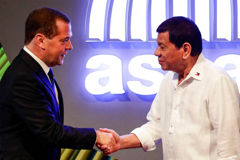 Russian Prime Minister Dmitry Medvedev, left, shakes hands with Philippine President Rodrigo Duterte before the opening ceremony of the 31st Association of Southeast Asian Nations (ASEAN) Summit in Manila, Philippines, Monday, Nov. 13, 2017. Mark Cristino/Pool Photo via AP