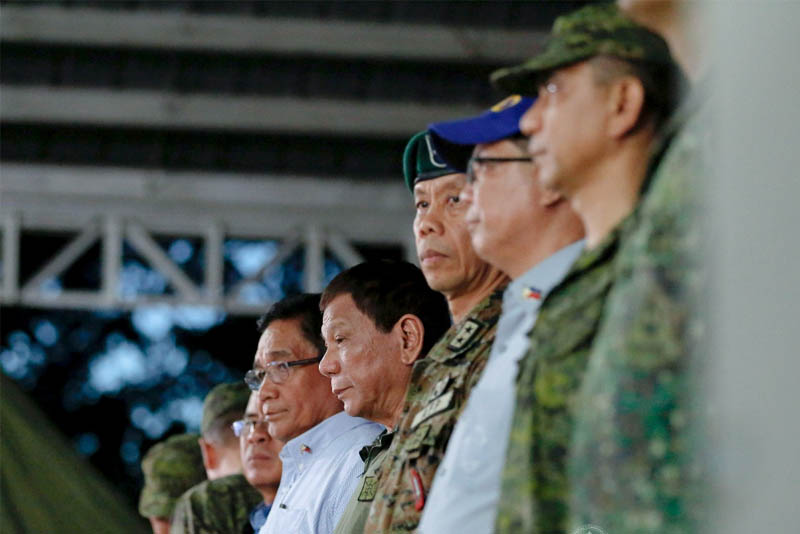 In this Nov. 22, 2017 photo, President Rodrigo Duterte witnesses the program proper during his visit at Fort Magsaysay in Palayan City, Nueva Ecija. Also in the photo are National Security Adviser Hermogenes Esperon Jr. and Special Operations Command Commander Major General Danilo Pamonag. PPD/Alfred Frias