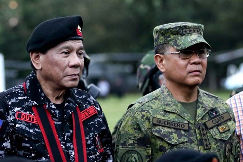 In this Nov. 24, 2017 photo, President Rodrigo Duterte poses for a photo with Armed Forces of the Philippines Chief of Staff General Rey Guerrero during a military capability demonstration during the 67th Founding Anniversary of FSRR at at Camp Tecson in San Miguel, Bulacan. PPD/Simeon Celi Jr.