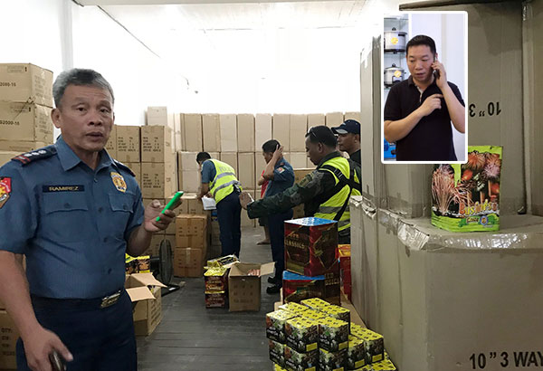 Police officers led by Senior Superintendent Ramil Ramirez inspect firecrackers recovered during a raid on electronic stores owned by James Sy (inset) in Ormoc yesterday. Lalaine Jimenea