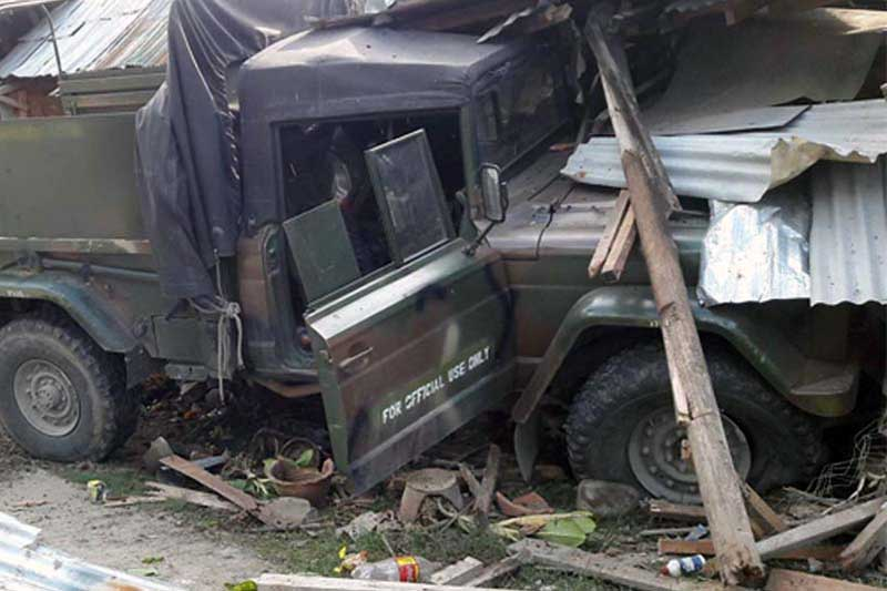 An Army utility truck hit by an IED believed set up by the Bangsamoro Islamic Freedom Fighters. John Unson