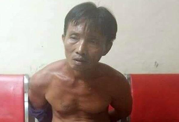 Ricky Castillano waits at the police station following his arrest in Valenzuela City Thursday night. Marc Jayson Cayabyab