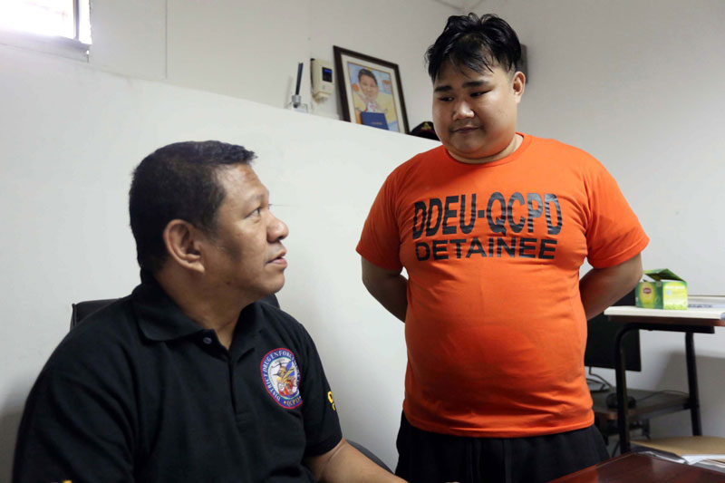 Mikey Gealogo Santos answers questions at Camp Karingal following his arrest in Quezon City Thursday night. Boy Santos