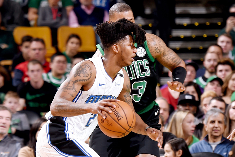Elfrid Payton of the Orlando Magic drives past Boston Celtics' Marcus Morris during their NBA clash  at the TD Garden in Boston. AFP