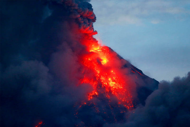 Mayon volcano spews red -hot lava in another eruption as seen from Legazpi city, Albay province, roughly 200 miles (340 kilometers) southeast of Manila, Philippines, Tuesday, Jan. 23, 2018. Mayon has spewed fountains of red-hot lava and massive ash plumes anew in a dazzling but increasingly dangerous eruption that has sent 56,000 villagers fleeing to evacuation centers. AP/Bullit Marquez