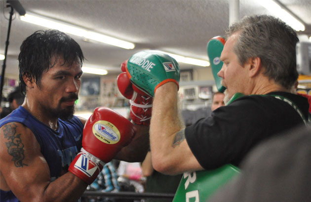 Manny Pacquiao works on the mitts with trainer Freddie Roach in this file photo.