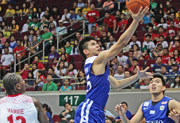 Ateneo's Kiefer Ravena goes up for an easy layup off Charles Mammie of UE while teammate Gwayne Capacio looks on. JUN MENDOZA
