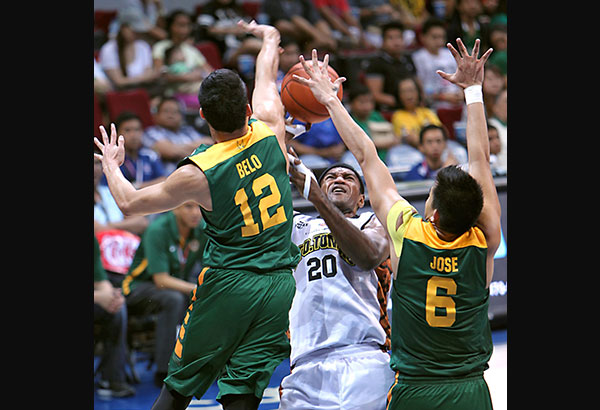 Raymar Jose (12) comes up big for the FEU Tamaraws in a big win against the UP Fighting Maroons as they caught the UST Growling Tigers on top of the standings. File Photo