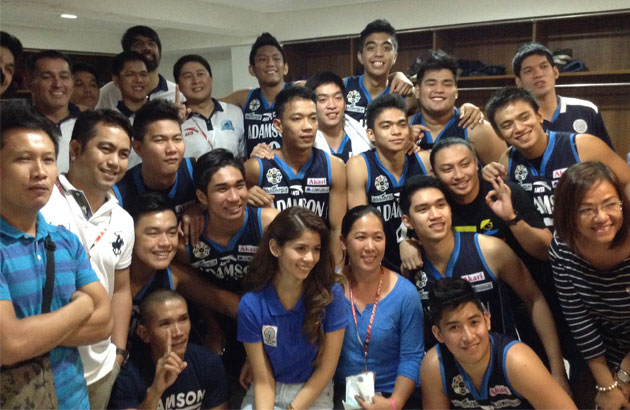 The Adamson Falcons pose after getting their first win in the 77th UAAP men's basketball tournament Tuesday