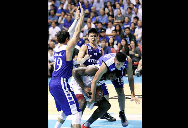 National U Alfred Aroga fights off Ateneo's triple-team defense composed of Gideon Babilonia (18), Von Pessumal (19) and Kiefer Ravena during their UAAP Final Four clash. JOEY MENDOZA JR.