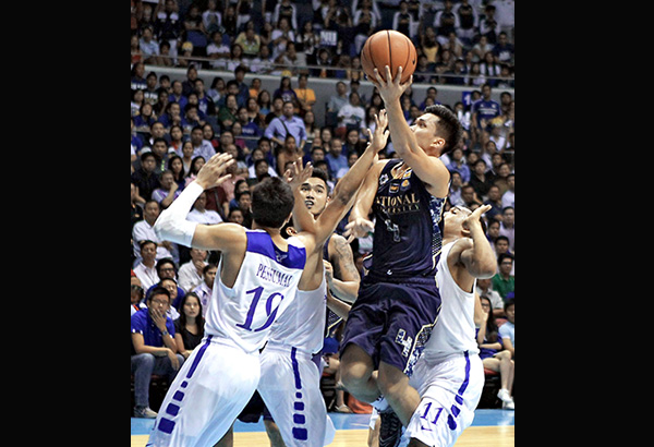 NU's Angelo Alolino drives into the heart of Ateneo's defense composed of Nico Elorde, Von Pessumal and Chris Newsome, using his left hand to score during their sudden death for the first finals berth in the UAAP men's basketball tournament. JOEY MENDOZA