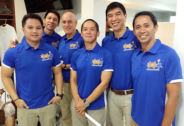 Talk 'N' Text head coach Jong Uichico (second from right) and (from left) assistant coaches Josh Reyes and Nash Racela, consultant Tab Baldwin, conditioning coach Dexter Aseron and team manager Aboy Castro.