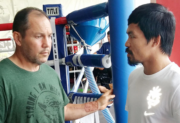 Justin Fortune briefs Manny Pacquiao on his conditioning regimen before training in General Santos City.