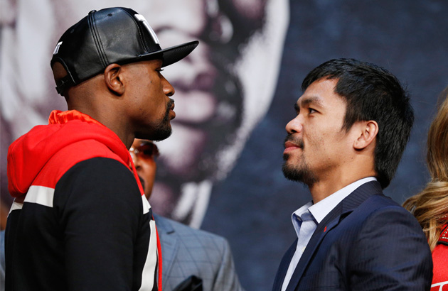 Boxers Floyd Mayweather Jr., left, and Manny Pacquiao pose for photographers during a press conference Wednesday, April 29, 2015, in Las Vegas. The pair are slated to square off Saturday in Las Vegas. AP Photo/John Locher