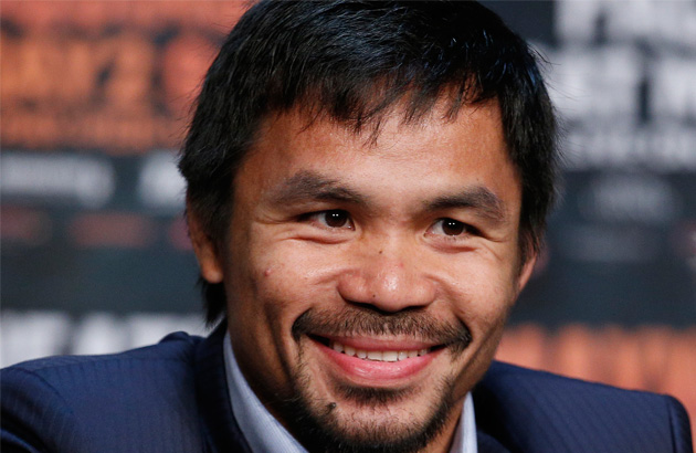 Manny Pacquiao smiles during a news conference Wednesday, April 29, 2015, in Las Vegas. Pacquiao will face Floyd Mayweather Jr. in a welterweight boxing match in Las Vegas on May 2. (AP Photo/John Locher)