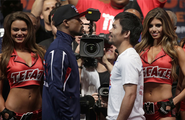 Floyd Mayweather Jr., left, and Manny Pacquiao pose during their weigh-in on Friday, May 1, 2015 in Las Vegas. The world weltherweight title fight between Mayweather Jr. and Pacquiao is scheduled for May 2. AP Photo/Chris Carlson