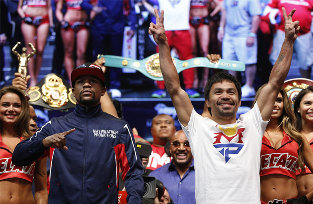 Floyd Mayweather Jr., left, and Manny Pacquiao pose during their weigh-in on Friday, May 1, 2015 in Las Vegas. The world weltherweight title fight between Mayweather Jr. and Pacquiao is scheduled for May 2. AP Photo/John Locher