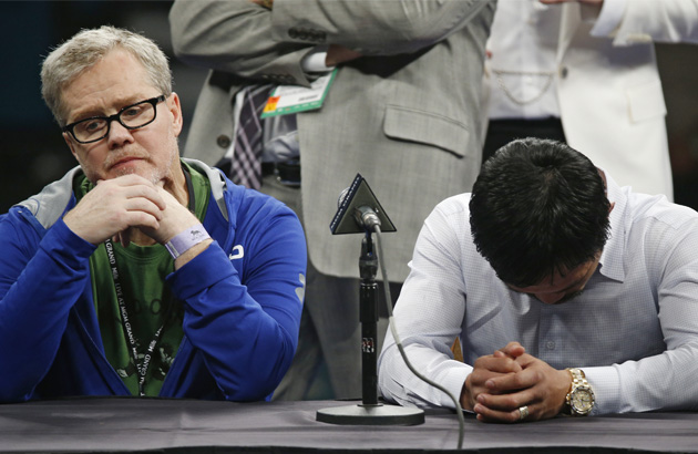 Trainer Freddie Roach and Manny Pacquiao face the media after losing the fight. AP