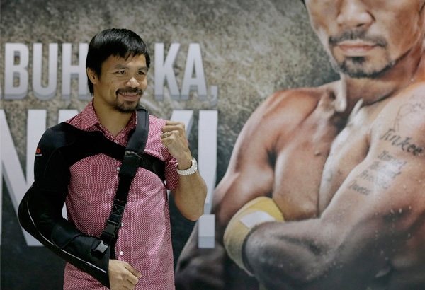 Manny Pacquiao poses for the media following a news conference upon arrival Wednesday, May 13, 2015 at the Ninoy Aquino International Airport at suburban Pasay city south of Manila, Philippines. Pacquiao, who was defeated by Floyd Mayweather Jr. in their welterweight fight in Las Vegas May 2, faces lawsuits allegedly for not disclosing his shoulder injury before the fight. AP Photo/Bullit Marquez