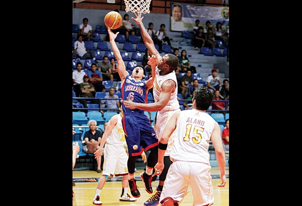 In this file photo,Jio Jalalon of Arellano goes for a lay-up against Perpetual's Nosa Omorogbe