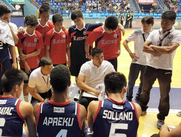 Aldin Ayo during one of his huddles with the Letran Knights. I File Photo
