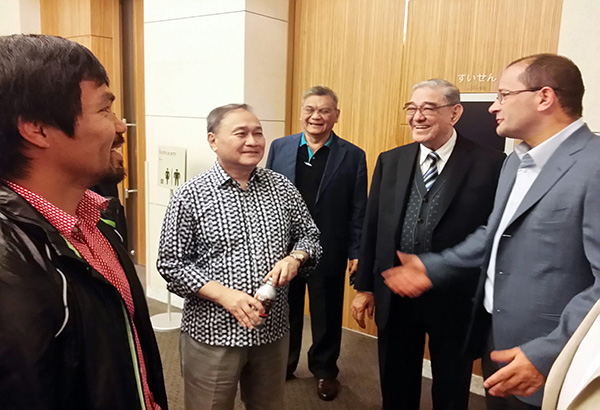 SBP president Manny V. Pangilinan (second from left) shares a light moment with FIBA secretary-general Patrick Baumann, Rep. Manny Pacquiao, SBP executive director Sonny Barrios and SBP senior consultant Moying Martelino during the FIBA 2019 World Cup bidding event in Tokyo.