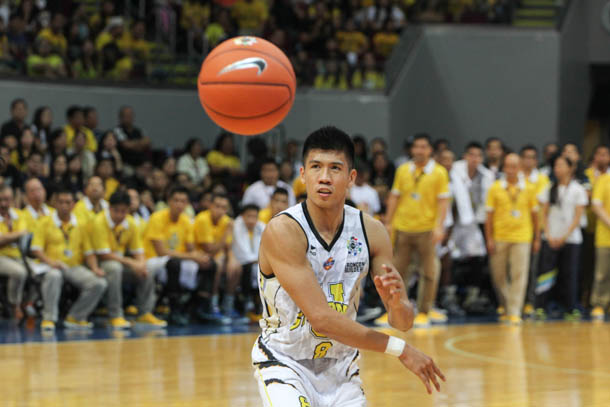 Ed Daquioag and the UST Growling Tigers rained triples on a hapless De La Salle Green Archers team to hike their record to 5-1 and a share of top spot in the UAAP men's basketball. File Photo