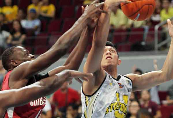 Kevin Ferrer logged in a double-double effort to lead UST past UP. File Photo
