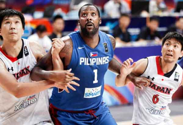 Gilas Pilipinas naturalized player Andray Blatche (center) gets entangled with Japanese Atsuya Ota (left) and Makoto Teijima as they jockey for position in a rebound play during their FIBA Asia Championship second round match in Changsha, China in 2015. The Philippines won, 73-66. | FIBA Asia photo