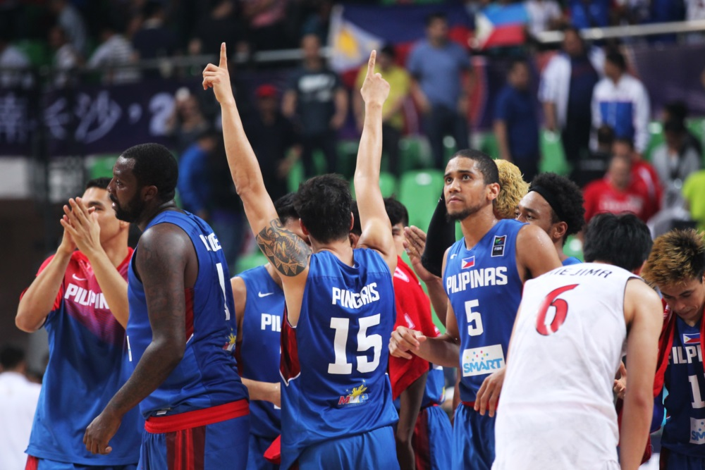 The Gilas Pilipinas in a huddle. | AP File Photo