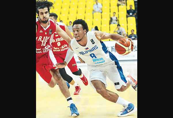 Calvin Abueva in action against Iran's Asghar Kardoust Poustinsaraei during the FIBA Asia Championship in Changsha in file photo. AP