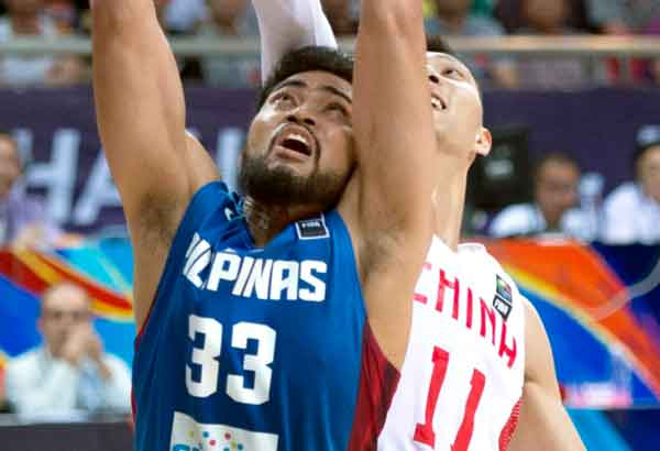 Ranidel de Ocampo and China's Yi Jianlian vie for the ball in the final of the FIBA Asia Championship in Changsha in south China's Hunan province. China won 78-67. AP file photo