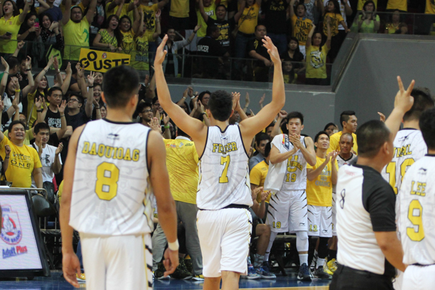 Kevin Ferrer (#14) gestures to the crowd during University of Santo Tomas' first round conquest of the University of the Philippines | Philstar.com File/Efigenio Toledo IV