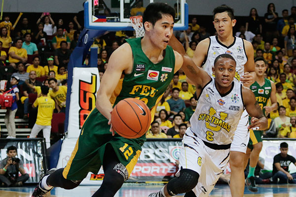 FEU's Mac Belo, UAAP Mythical 5 member and eventual Finals MVP, drives past UST's Jamil Sheriff during the 2nd half of the UAAP Finals Game 3 at the Mall of Asia Arena, Wednesday. The Tamaraws kept the Tigers at bay late in the fourth, copping their 20th championship in the league. | Efigenio Toledo IV/Philstar.com