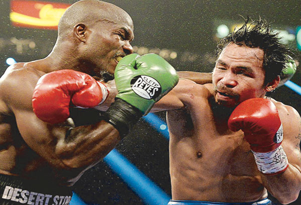 Manny Pacquiao and Tim Bradley in action. FILE PHOTO