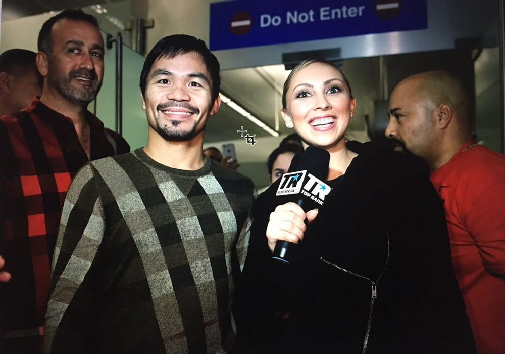 Manny Pacquiao poses with TV host Crystina Poncherduring an interview upon his arrival at the Los Angeles International Airport early Tuesday. | Screengrab from Top Rank's video
