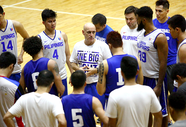 Coach Tab Baldwin (center) with some Gilas and coaching staff members in file photo.